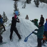 Snowshoeing and bivouac in igloo in Vercors